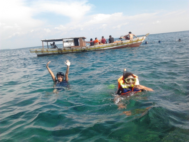 Pose in the middle of the sea with Mrs. Amutha!!